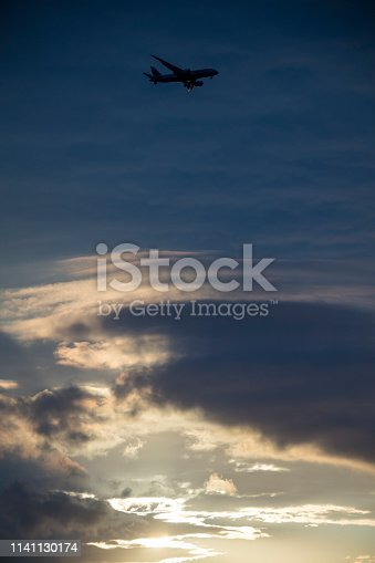 155439315istockphoto Passenger airplane flying above clouds 1141130174