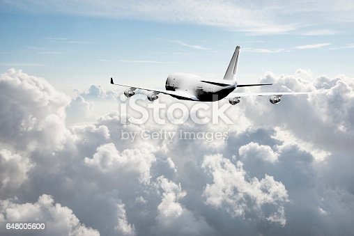 155380716 istock photo Passenger airplane flying above clouds 648005600