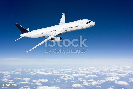 istock Passenger airplane flying above clouds 943681768