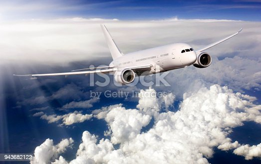 155380716 istock photo Passenger airplane flying above clouds 943682122