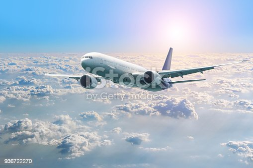 istock Passenger airplane flying above clouds. View from the window plane to amazing sky at the sunset. Air company. Airline. 936722270