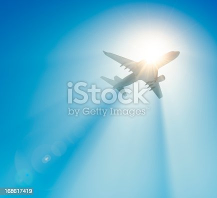 istock Passenger airplane flying against the sun 168617419