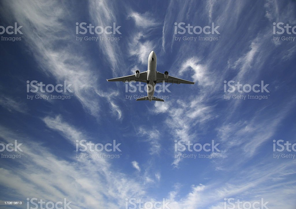 Passenger Airplane Flying in the sky royalty-free stock photo
