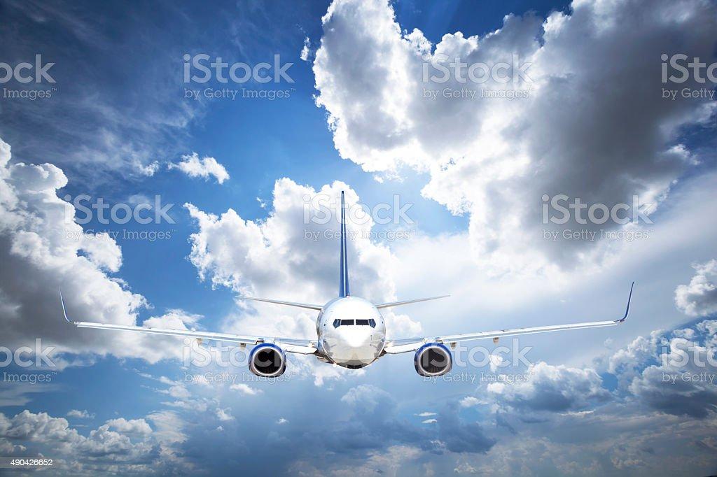 Passenger airplane flying stock photo