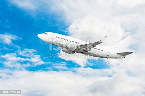494996104 istock photo Passenger airplane flying travel, trip at flight level over the white clouds. 1003325114