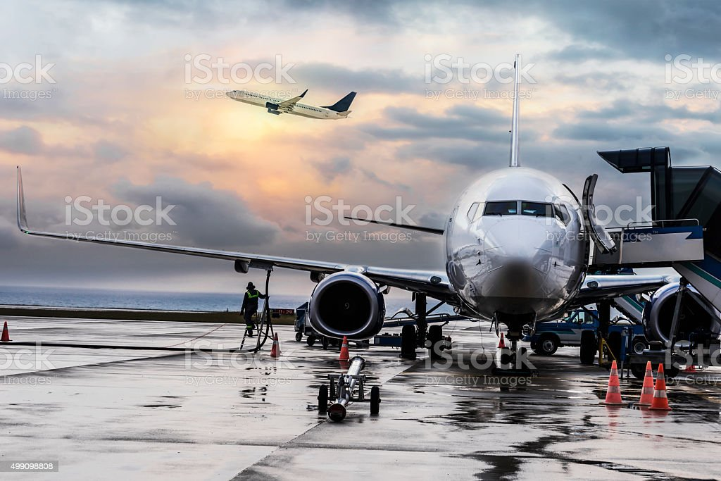 Passenger airplane getting ready for flight stock photo