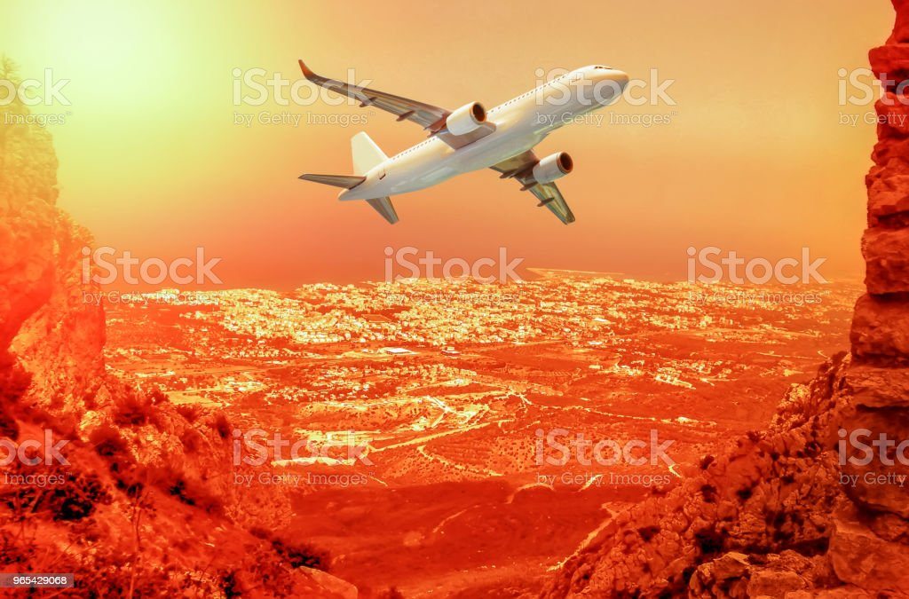 Passenger airplane in the clouds. Beautiful view of the new port of Kyrenia (Girne), North Cyprus royalty-free stock photo