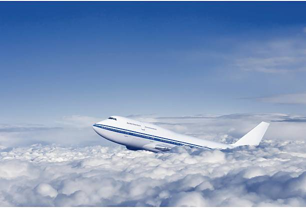passenger airplane in the clouds. - aviation and environment summit stock photos and pictures