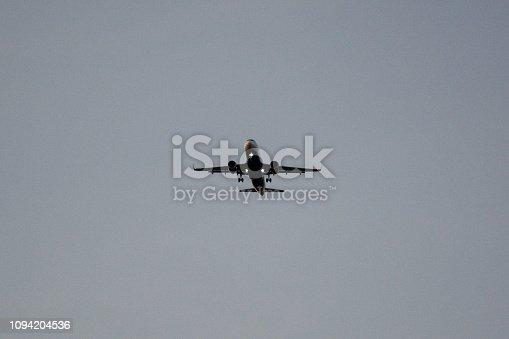 494996104 istock photo Passenger airplane landing against blue cloudy sky 1094204536