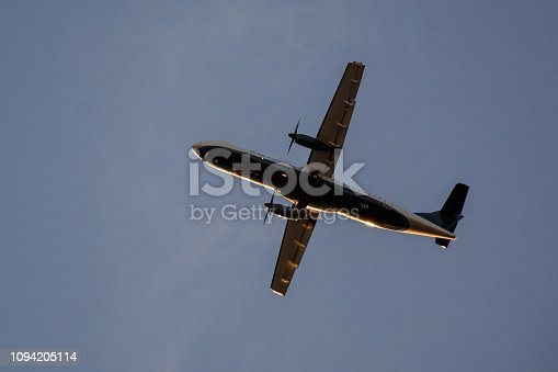 494996104istockphoto Passenger airplane landing against blue cloudy sky 1094205114