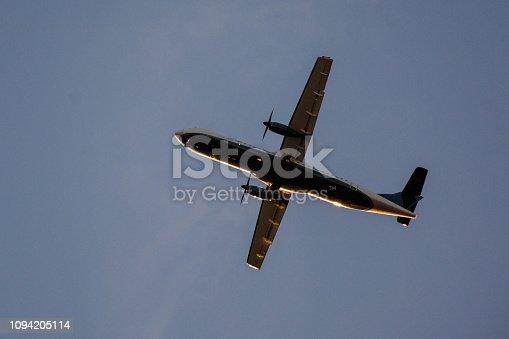 494996104 istock photo Passenger airplane landing against blue cloudy sky 1094205114