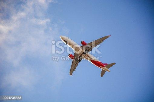 494996104 istock photo Passenger airplane landing against blue cloudy sky 1094205558