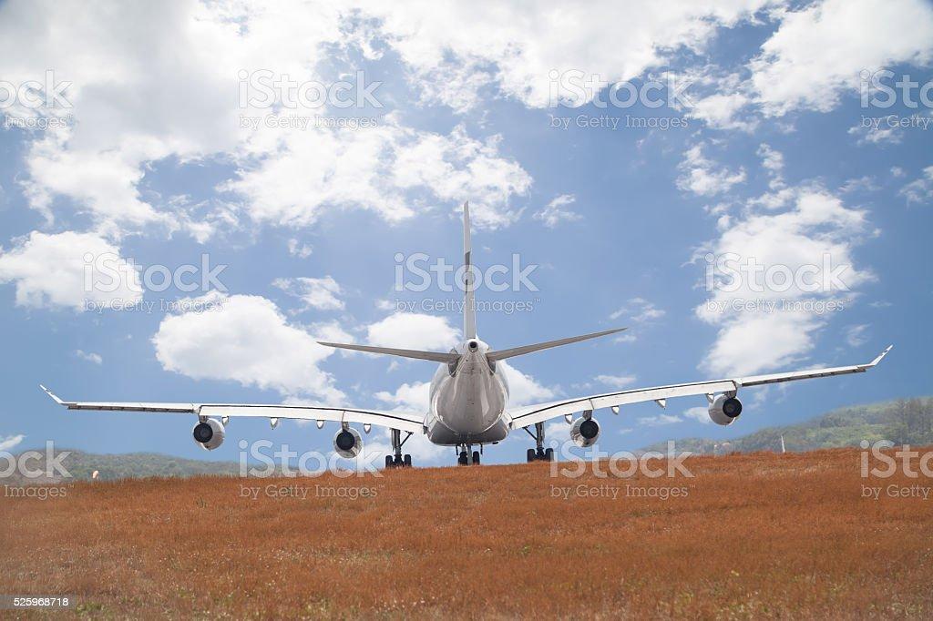 Passenger airplane landing blue sky background. stock photo