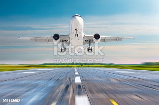 494996104istockphoto Passenger airplane landing on a runway airport. 951113692