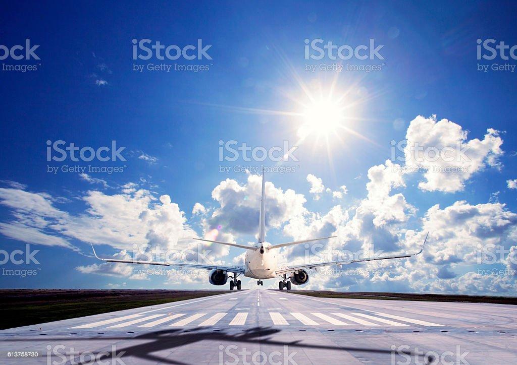 Passenger airplane Landing on pist stock photo