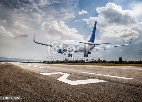 istock Passenger airplane landing 1182691458