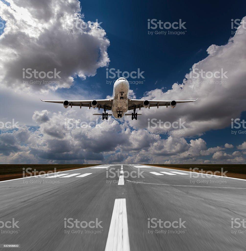 Passenger airplane landing stock photo