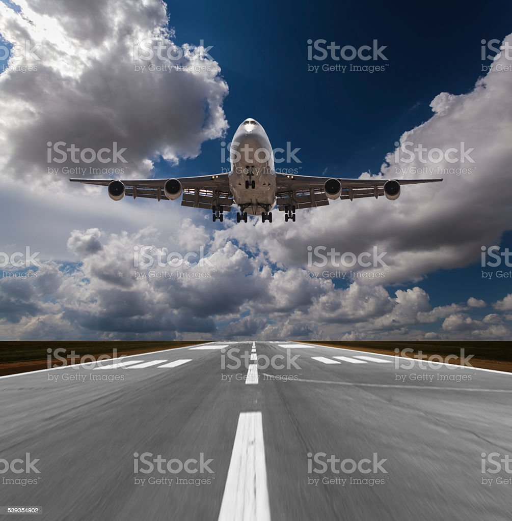 Passenger airplane landing stock photo