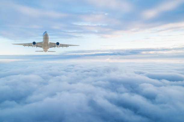 Passenger airplane on the clouds background. Flight in stratosphere. stock photo