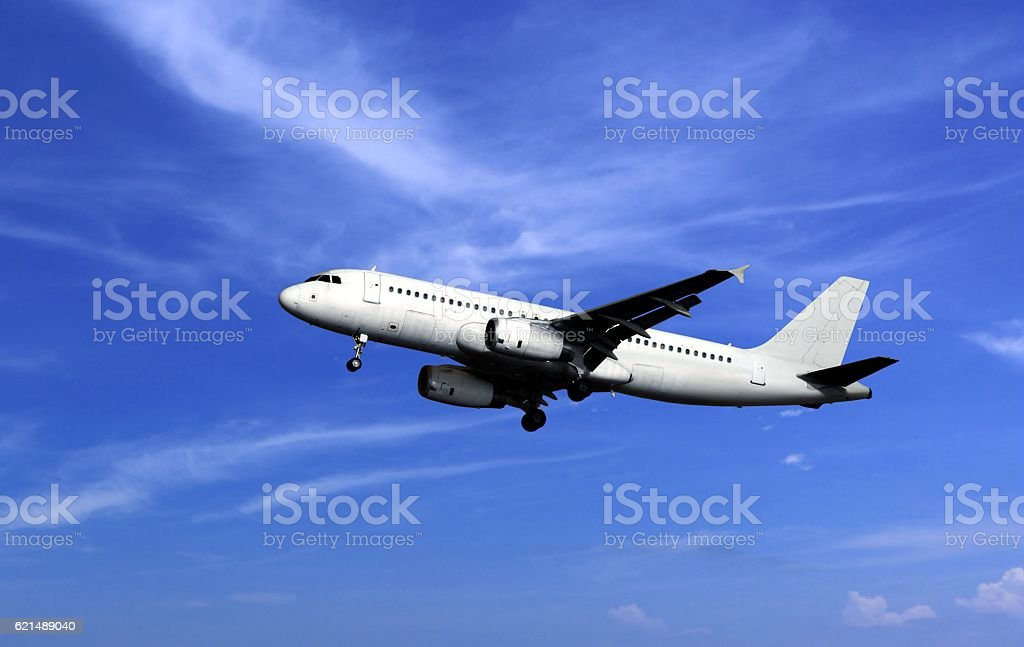 Passenger airplane take off under cloudy blue sky Lizenzfreies stock-foto