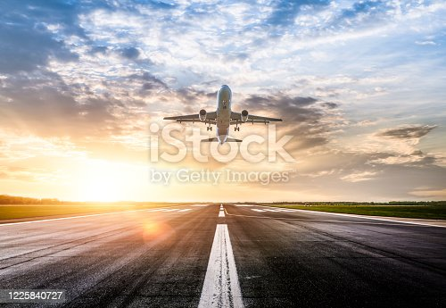 Passenger airplane taking of at sunrise