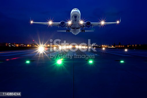 864534880 istock photo Passenger airplane taking off at night 1140854244