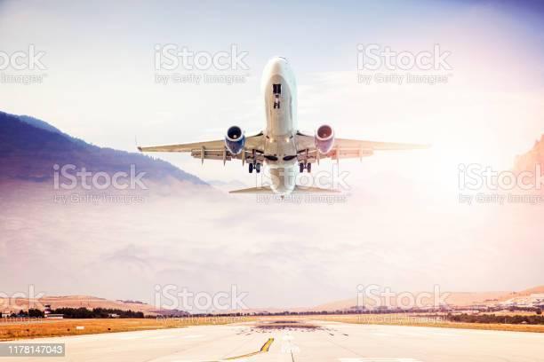 Photo of Passenger airplane taking off at sunset