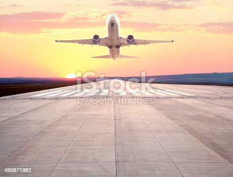 494996104istockphoto passenger airplane taking off at sunset 495871982