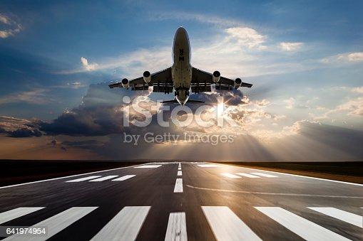 istock Passenger airplane taking off at sunset 641974954