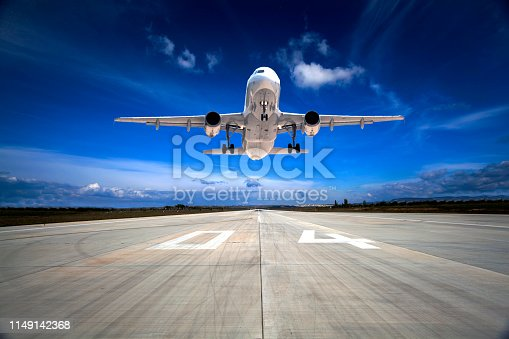 864534880 istock photo Passenger airplane taking off 1149142368