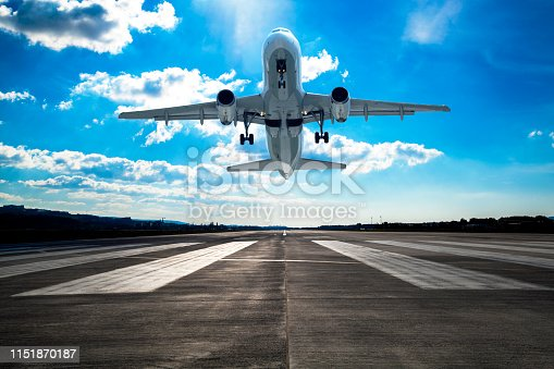 864534880 istock photo Passenger airplane taking off 1151870187