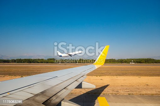 494996104istockphoto Passenger airplane taking off 1175083295