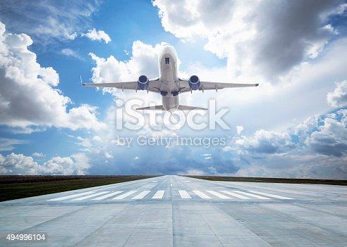 istock Passenger airplane taking off 494996104