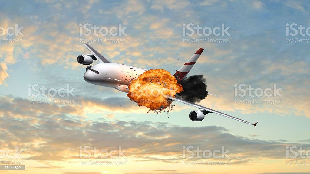 Passenger Airplane with a big explosion in the sky stock photo