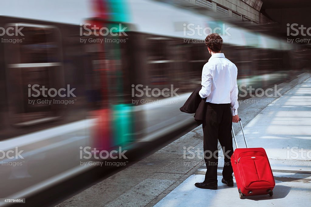 passenger at the train station stock photo