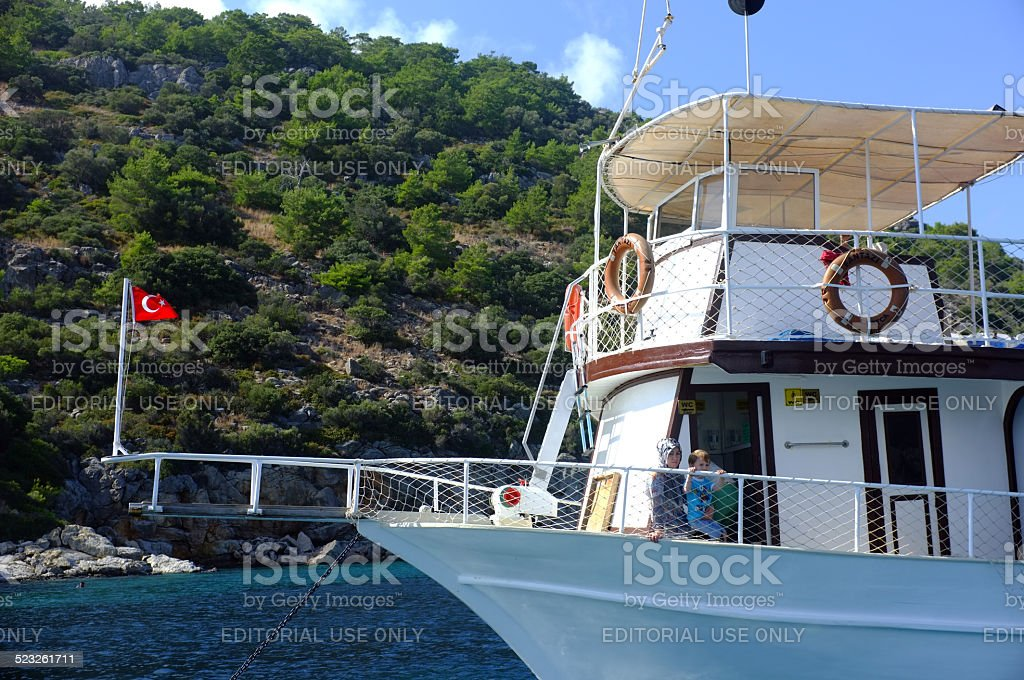 Passenger boat anchored with the passengers on stock photo