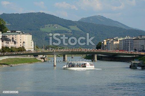 Salzburg, Austria - September 1, 2015: Passenger boat on Salzach river in Salzburg in Austria. Unidentified people visible.