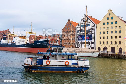 Gdansk, Poland - February 05, 2019: Passenger boat on the background of the Maritime museum on the Motlawa River in Gdansk, Poland