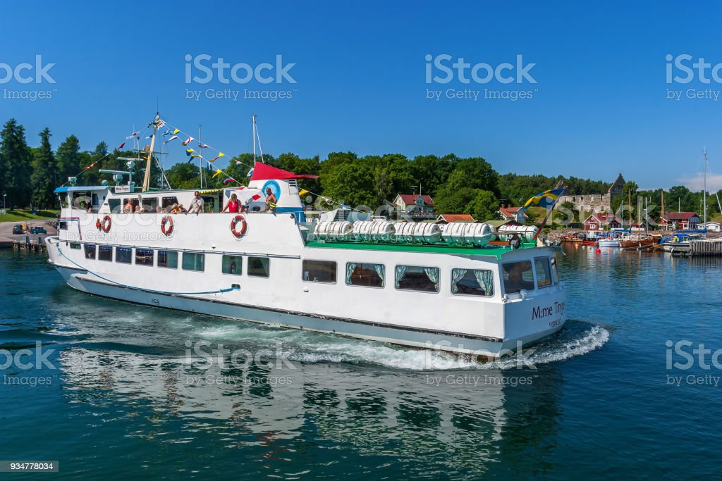 Passenger boat with tourists heading into Visingso Harbour in Sweden stock photo