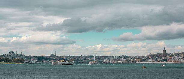 passenger boats at front of galata tower istanbul stok fotoğrafı