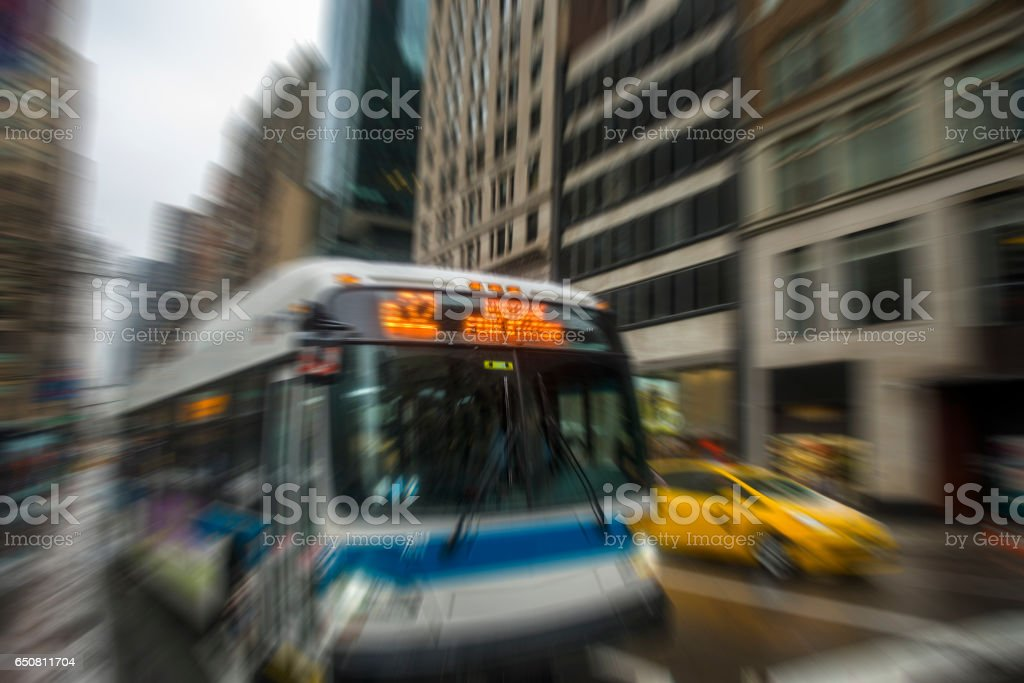 Passenger bus and yellow taxi moving in Manhattan, New York stock photo