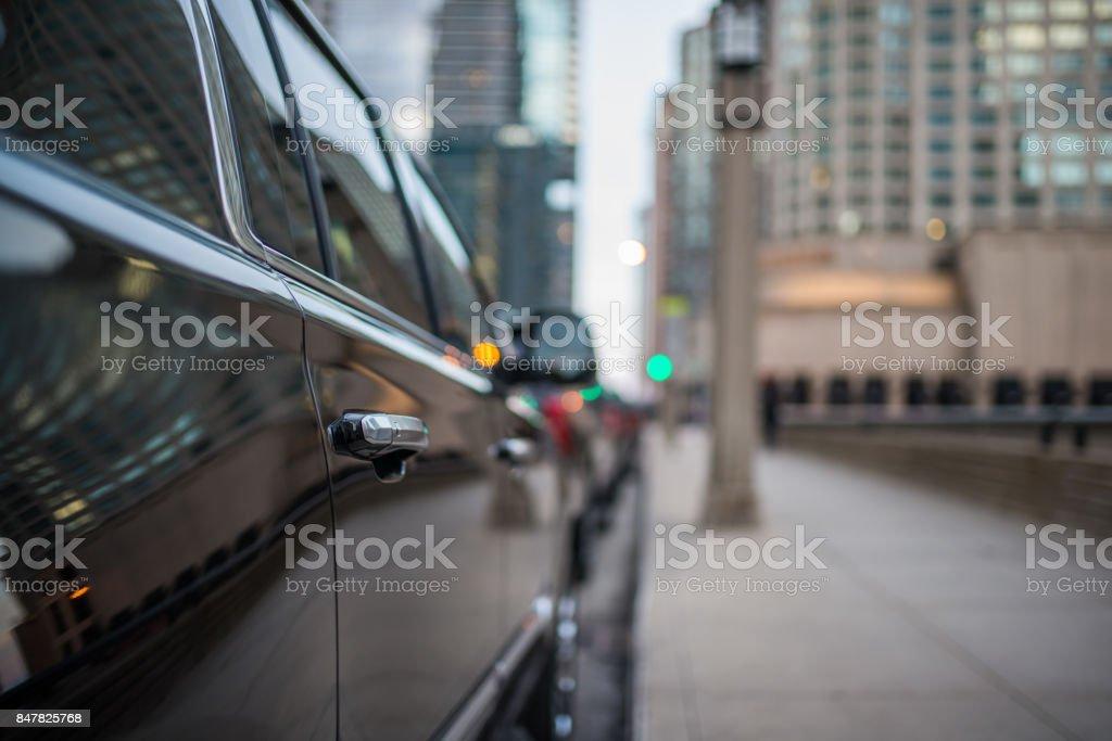Passenger door handle of a black SUV stock photo
