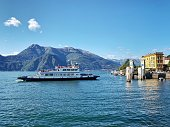 Varenna, Lake Como, Italy - 23rd September 2019: Passenger ferry arrives at the Jetty in Varenna, an attractive village on the eastern shore of Lake Como.