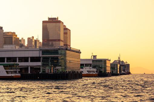 Passenger ferry by the pier. Hong Kong
