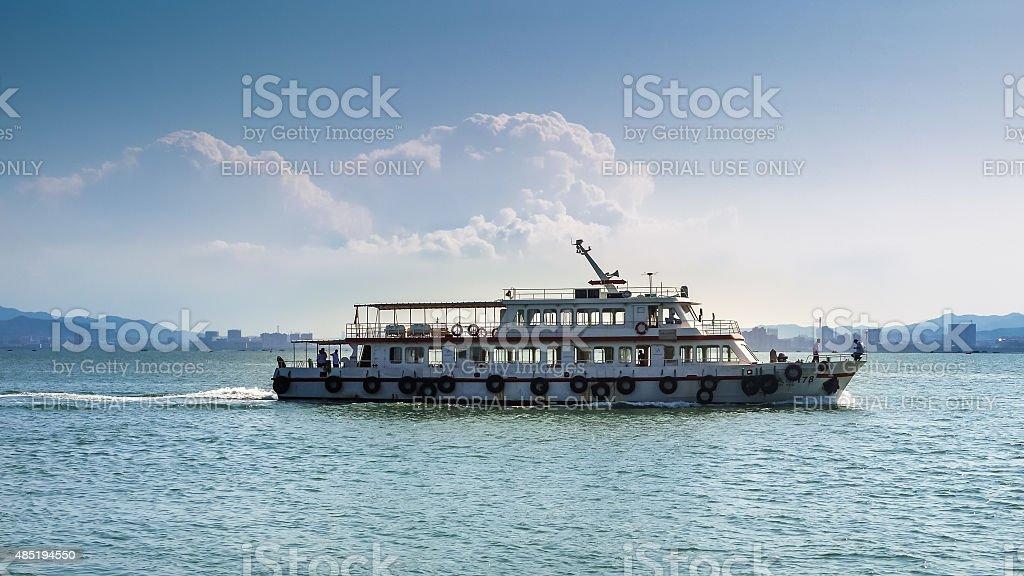 Passenger ferry crosses Weihai Harbor on a sunny day stock photo
