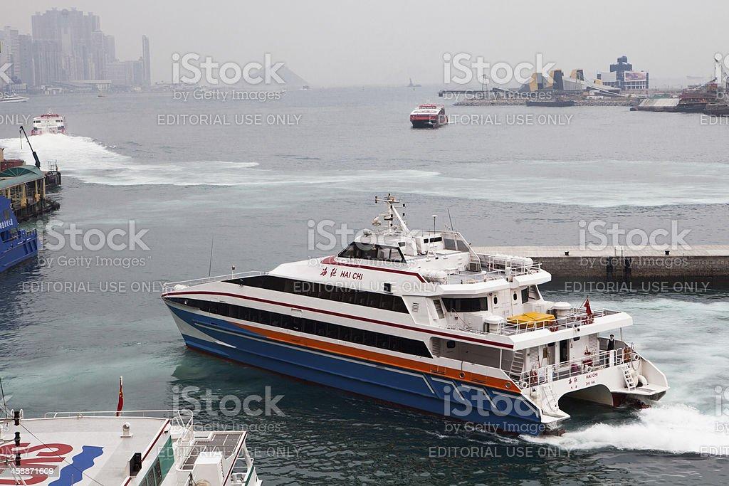 Passenger ferry leaves Hong Kong Harbor for China stock photo