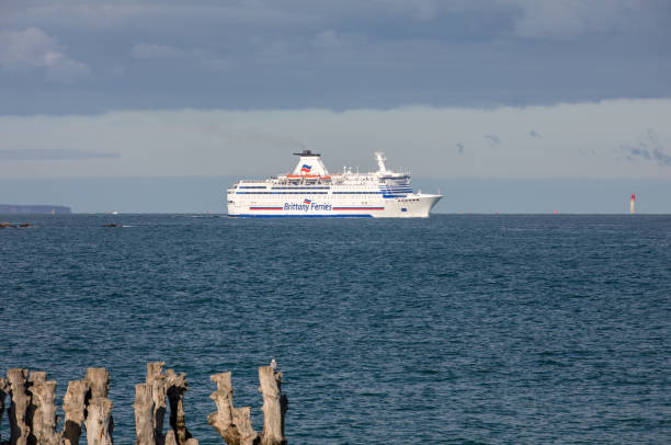 Passenger ferry leaving the port of Saint Malo in the morning in the direction of United Kingdom stock photo