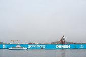 Gothenburg , Sweden – March 22 2016: Passenger ferry Älvfrida passing floating docks at Lindholmen..