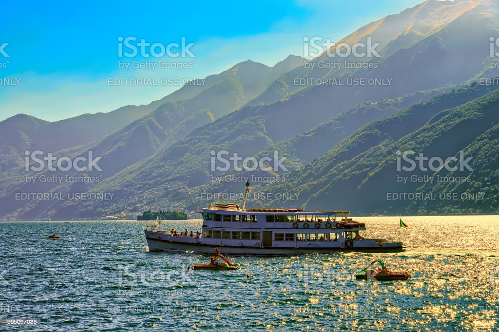 Passenger ferry ship and catamarans in Ascona in Switzerland CH royalty-free stock photo