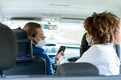 istock Passenger giving directions to a mobile application driver to reach their destination 1282421109